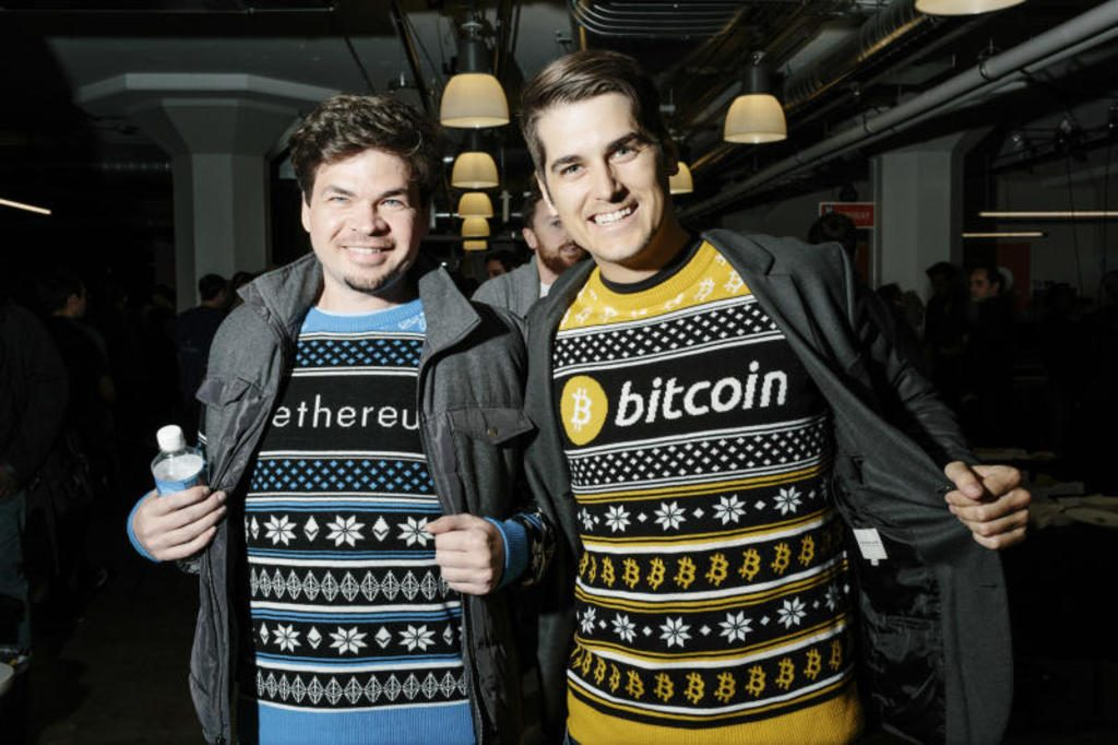 Participants show off their enthusiasm for cryptocurrencies at the annual San Francisco Bitcoin Meetup Party on Dec 14, 2017.